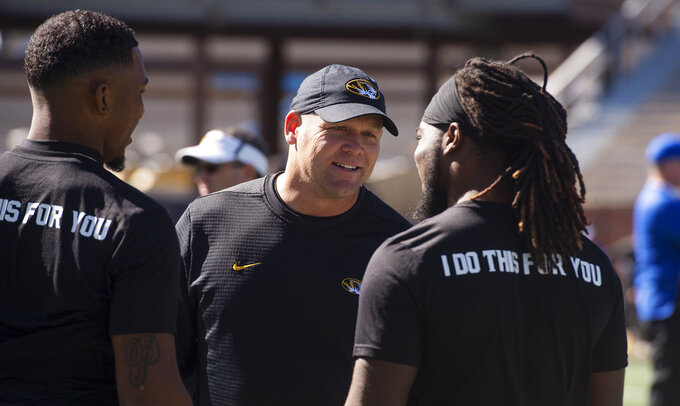 Missouri head coach Barry Odom, center, talks with Memphis players before the start of an NCAA college football game, Saturday, Oct. 20, 2018, in Columbia, Mo. (AP Photo/L.G. Patterson)
