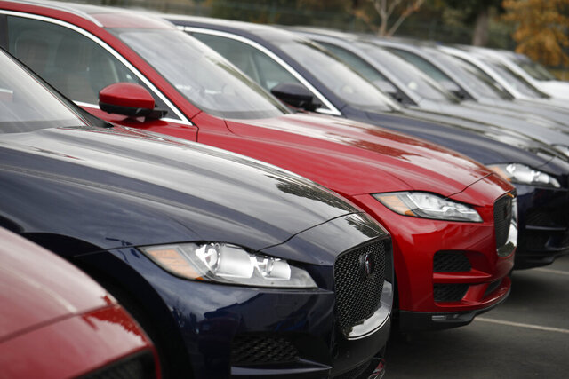 FILE - In this Oct. 20, 2019, file photo a long row of unsold 2019 F-Pace sports-utility vheicles sits at a Jaguar dealership in Littleton, Colo. (AP Photo/David Zalubowski, File)