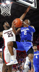 Kentucky guard Ashton Hagans (2) goes up for a shot as Georgia forward Amanze Ngumezi (25) defends during the first half of an NCAA college basketball game Tuesday, Jan. 15, 2019, in Athens, Ga. (AP Photo/John Bazemore)