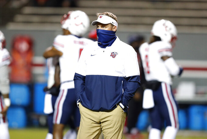 Liberty head coach Hugh Freeze watches as his team warms up before an NCAA college football game against Nort Carolina State in Raleigh, N.C., Saturday, Nov. 21, 2020. (Ethan Hyman/The News & Observer via AP, Pool)