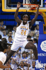 UCLA forward Jalen Hill, center, celebrates as he dunks during the first half of an NCAA college basketball game against California Sunday, Jan. 19, 2020, in Los Angeles. (AP Photo/Mark J. Terrill)