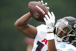 Atlanta Falcons wide receiver Russell Gage (14) runs drills during NFL football practice on Tuesday, Aug. 3, 2021, in Flowery Branch, Ga. (AP Photo/Brynn Anderson)