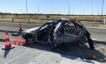 A damaged car sits at toll stations still under construction in the village of Ardanio, near Alexandroupolis town, northeastern Greece, Wednesday, Aug. 5, 2020. Police say the car is believed to have been transporting migrants who recently entered the country illegally and crashed into roadworks on a highway overnight, killing seven people and injuring five. (e-evros.gr via AP)