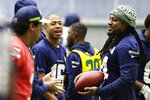Seattle Seahawks running back Marshawn Lynch, right, warms up near quarterback Russell Wilson, left, and wide receiver Tyler Lockett, second from left, before NFL football practice, Friday, Dec. 27, 2019, in Renton, Wash. (AP Photo/Ted S. Warren)