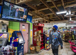 """Roland Jackson looks up to a TV to check on the Derek Chauvin trial while getting some breakfast inside the Cup Foods at George Floyd Square in Minneapolis, Minn., on Monday, March 29, 2021. """"I just want justice to be served,"""" said Jackson. (Richard Tsong-Taatarii/Star Tribune via AP)"""