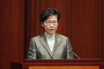 """Hong Kong Chief Executive Carrie Lam delivers her policies at chamber of the Legislative Council in Hong Kong, Wednesday, Nov. 25, 2020. Lam said Wednesday that the city's new national security law has been """"remarkably effective in restoring stability"""" after months of political unrest, and that bringing normalcy back to the political system is an urgent priority. (AP Photo/Kin Cheung)"""