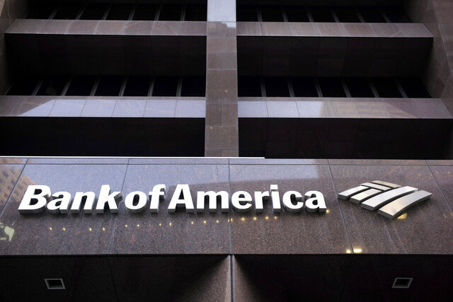 FILE - In this Oct. 14, 2019, file photo a Bank of America logo is attached to the exterior of the Bank of America Financial Center building in Boston. The Federal Reserve said on Thursday, June 25, 2020, a worst-case scenario for the U.S. economy ravaged by the coronavirus pandemic would cause nation's 34 largest banks to collectively lose roughly $700 billion. To bolster the banks ahead such a potentially damaging recession, the Fed ordered the banks to suspend stock buybacks and dividend payouts until Sept. 30. (AP Photo/Steven Senne)
