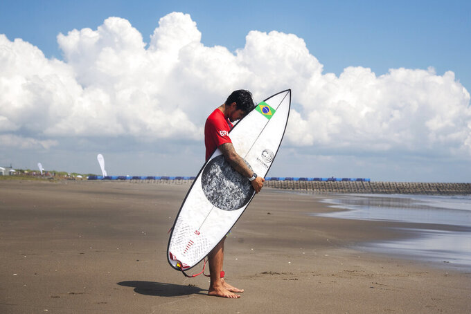 Brazil's Gabriel Medina prays before his heat during the first round of the men's surfing competition at the 2020 Summer Olympics, Sunday, July 25, 2021, at Tsurigasaki beach in Ichinomiya, Japan. (Olivier Morin/Pool Photo via AP)
