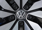FILE - In this April 28, 2017 file photo an e-Golf electric car with the VW logo on a rim is pictured in the German car manufacturer Volkswagen Transparent Factory (Glaeserne Manufaktur) in Dresden, eastern Germany. (AP Photo/Jens Meyer, file)