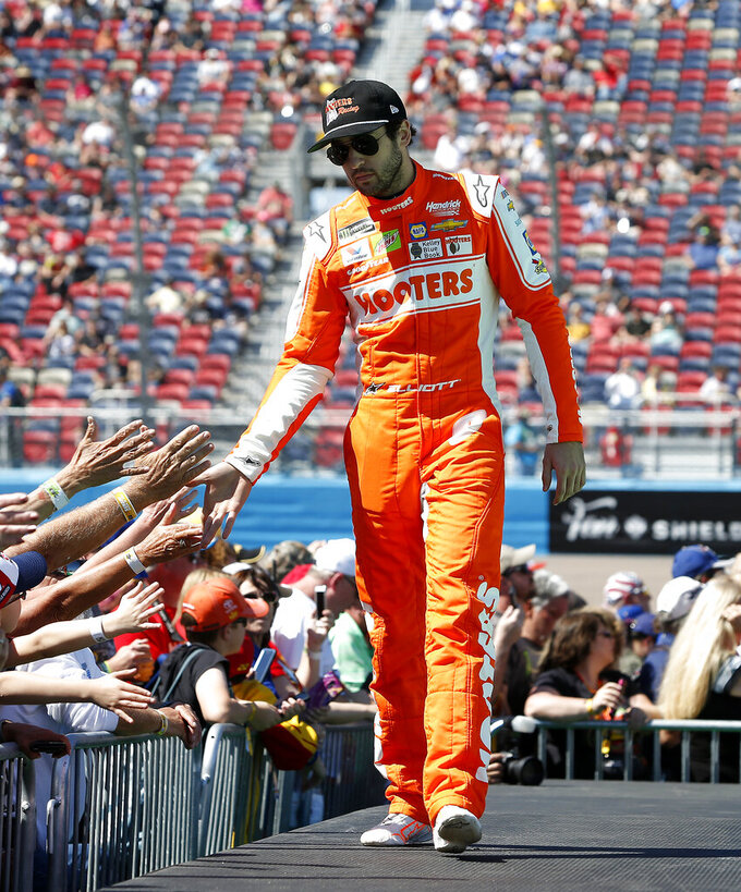 Chase Elliott is greeted by fans during driver introductions prior to the start of the NASCAR Cup Series auto race at ISM Raceway, Sunday, March 10, 2019, in Avondale, Ariz. (AP Photo/Ralph Freso)