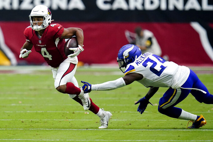 Arizona Cardinals wide receiver Rondale Moore (4) runs as Minnesota Vikings cornerback Mackensie Alexander (24) defends during the first half of an NFL football game, Sunday, Sept. 19, 2021, in Glendale, Ariz. (AP Photo/Ross D. Franklin)