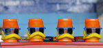 Duck mugs rest on a shelf before a minor league baseball game between the Akron RubberDucks and the Bowie Baysox, Thursday, April 18, 2019, in Akron, Ohio. (AP Photo/Tony Dejak)