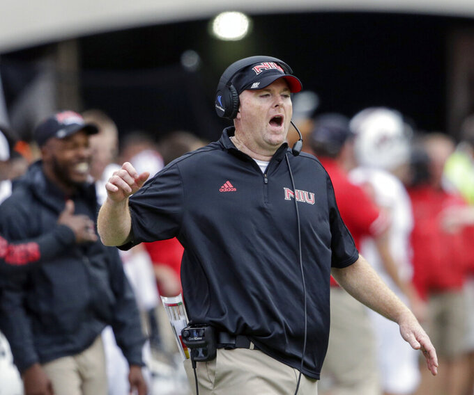 FILE - In this Sept. 16, 2017, file photo, Northern Illinois head coach Rod Carey calls instructions during the second half of an NCAA college football game against Nebraska, in Lincoln, Neb. A person familiar with the move tells The Associated Press that Temple has hired Northern Illinois coach Rod Carey as its next football coach. The person spoke Friday, Jan. 11, 2019, on condition of anonymity because Temple had not made an official announcement.  (AP Photo/Nati Harnik, File)