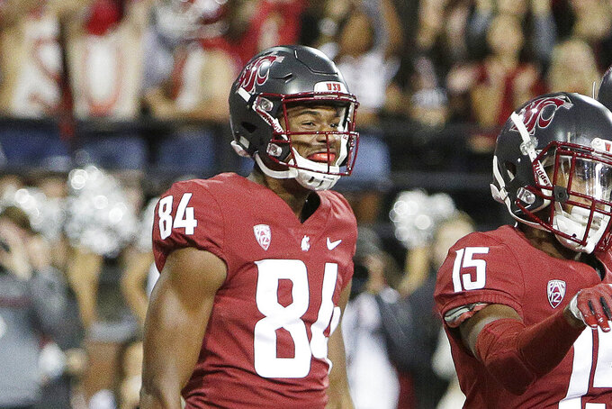Washington State wide receiver Kassidy Woods (84) looks on as wide receiver Robert Lewis (15) celebrates his touchdown during the second half of an NCAA college football game against Eastern Washington in Pullman, Wash., on Sept. 15, 2018. Woods, a former football player for Washington State University, contends in a lawsuit, filed Friday Aug. 20, 2021, in federal court for the northern district of Texas in Dallas, that his civil rights were violated when he was kicked off the football team after complaining about potential exposure to COVID-19 and for joining an association of Black student-athletes.  (AP Photo/Young Kwak)