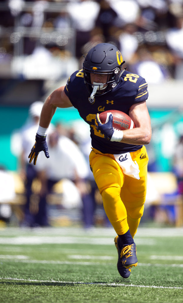 California's Patrick Laird (28) runs for 16 yards during the first half of an NCAA college football game against North Carolina, Saturday, Sept. 1, 2018, in Berkeley, Calif. (AP Photo/D. Ross Cameron)