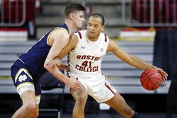 Boston College's Steffon Mitchell (41) looks to move on Notre Dame's Nate Laszewski during the first half of an NCAA college basketball game, Saturday, Feb. 27, 2021, in Boston. (AP Photo/Michael Dwyer)