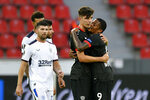 Leverkusen's Kai Havertz celebrates with Leon Bailey, right, at the end of the Europa League round of 16, second leg, soccer match between Bayer Leverkusen and Glasgow Rangers at the BayArena in Leverkusen, Germany, Thursday, Aug. 6, 2020. (Sascha Schuermann, Pool Photo via AP)