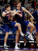 Liberty's Zach Farquhar, left, and Keegan McDowell celebrate during the second half of a first round men's college basketball game against Mississippi State in the NCAA tournament Friday, March 22, 2019, in San Jose, Calif. (AP Photo/Ben Margot)