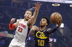 Cleveland Cavaliers' Darius Garland (10) drives to the basket against Detroit Pistons' Blake Griffin (23) in the first half of an NBA basketball game, Tuesday, Dec. 3, 2019, in Cleveland. (AP Photo/Tony Dejak)