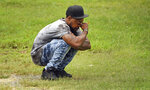 Kiwannie James Sr. wipes his eyes as he waits to get word about his son, Kiwannie James Jr. as he waits near the intersection of Polo Road and Petree Road after a shooting that left one student dead at Mount Tabor High School in Winston-Salem, N.C., Wednesday, Sept. 1, 2021. James got word that his son was safe about 10 minutes later. (Walt Unks/The Winston-Salem Journal via AP)
