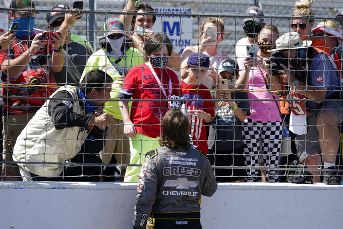 Sheldon Creed talks to fans after winning a NASCAR Truck Series race at World Wide Technology Raceway on Sunday, Aug. 30, 2020, in Madison, Ill. (AP Photo/Jeff Roberson)