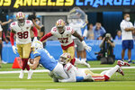Los Angeles Chargers quarterback Easton Stick (2) is tackled by San Francisco 49ers defensive end Arik Armstead during the first half of a preseason NFL football game Sunday, Aug. 22, 2021, in Inglewood, Calif. (AP Photo/Jae C. Hong)