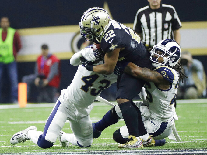 Los Angeles Rams' John Johnson (43) and Mark Barron stop New Orleans Saints' Mark Ingram during the second half of the NFL football NFC championship game, Sunday, Jan. 20, 2019, in New Orleans. (AP Photo/David J. Phillip)