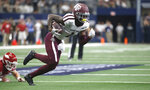 Texas A&M wide receiver Quartney Davis (1) takes a pass to the end zone past Arkansas linebacker Hayden Henry (27) during the first half of an NCAA college football game Saturday, Sept. 28, 2019, in Arlington, Texas. (AP Photo/Ron Jenkins)