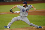 Los Angeles Dodgers starting pitcher Clayton Kershaw throws against the Tampa Bay Rays during the first inning in Game 5 of the baseball World Series Sunday, Oct. 25, 2020, in Arlington, Texas. (AP Photo/Eric Gay)