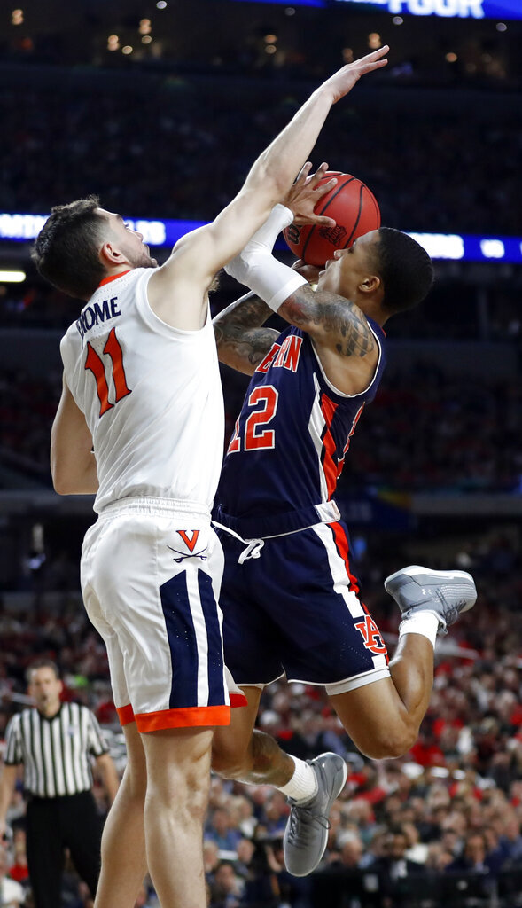 Auburn's J'Von McCormick (12) shoots against Virginia's Ty Jerome (11) during the second half in the semifinals of the Final Four NCAA college basketball tournament, Saturday, April 6, 2019, in Minneapolis. (AP Photo/Jeff Roberson)
