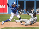 Seattle Mariners' Tim Lopes is out on the force out at second base as Toronto Blue Jays Bo Bichette turns the double play in the ninth inning of their baseball game in Toronto Sunday Aug. 18, 2019. (Fred Thornhill/The Canadian Press via AP)