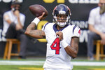 Houston Texans quarterback Deshaun Watson (4) passes against the Houston Texans in the first half of an NFL football game, Sunday, Sept. 27, 2020, in Pittsburgh. (AP Photo/Gene J. Puskar)