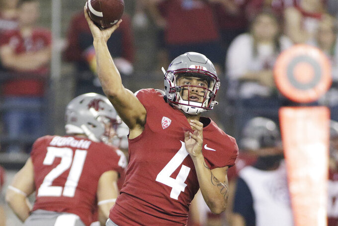 Washington State quarterback Jayden de Laura throws a pass during the second half of an NCAA college football game against Utah State, Saturday, Sept. 4, 2021, in Pullman, Wash. Utah State won 26-23. (AP Photo/Young Kwak)