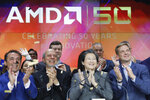 FILE - In this May 1, 2019, file photo, Lisa Su, second from right, president and CEO of AMD, attends the opening bell at Nasdaq to celebrate its 50th anniversary in New York. AMD is buying processing platform developer Xilinx in an all-stock deal valued at $35 billion. (AP Photo/Mark Lennihan)