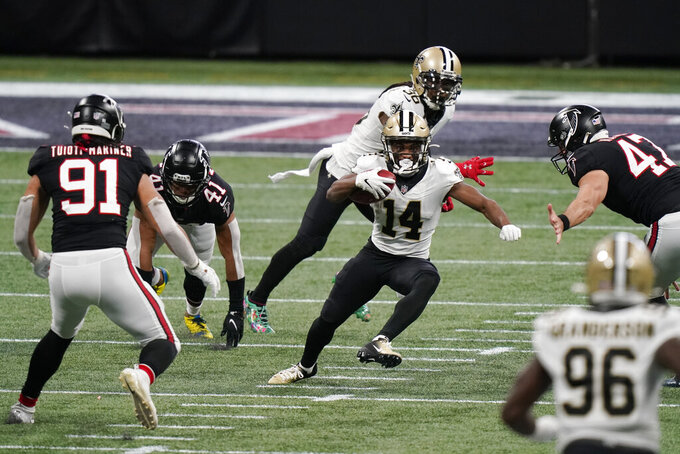 New Orleans Saints wide receiver Tommylee Lewis (14) runs in a field of Atlanta Falcons during the first half of an NFL football game, Sunday, Dec. 6, 2020, in Atlanta. (AP Photo/Brynn Anderson)