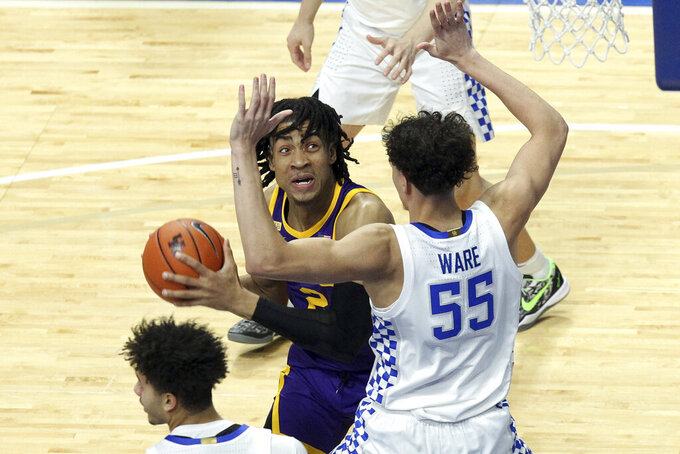 LSU's Trendon Watford, left, is pressured by Kentucky's Lance Ware (55) during the first half of an NCAA college basketball game in Lexington, Ky., Saturday, Jan. 23, 2021. (AP Photo/James Crisp)