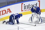 Toronto Maple Leafs defenceman Tyson Barrie (94) is slow to get up off the ice as Leafs goaltender Frederik Andersen (31) looks during the second period of an NHL Eastern Conference Stanley Cup playoff game in Toronto on Sunday, Aug. 9, 2020. (Nathan Denette/The Canadian Press via AP)