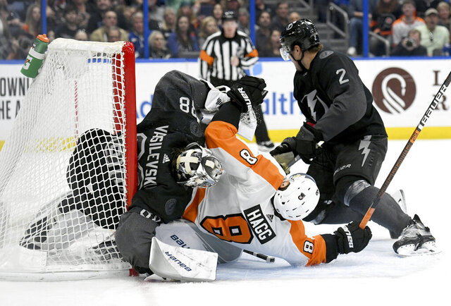 Philadelphia Flyers defenseman Robert Hagg (8) collides with Tampa Bay Lightning goaltender Andrei Vasilevskiy (88) during the third period of an NHL hockey game Saturday, Feb. 15, 2020, in Tampa, Fla. (AP Photo/Jason Behnken)