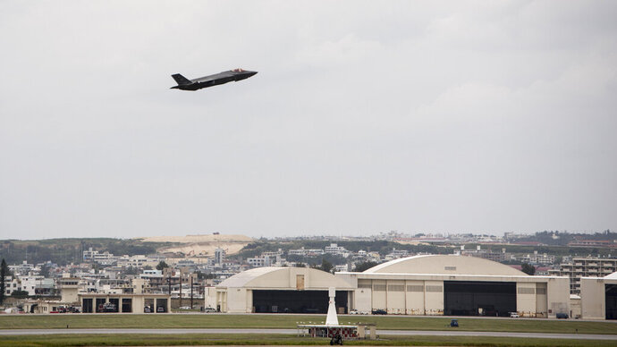In this Nov. 16, 2017 photo made available by the U.S. Air Force, a fighter plane takes-off from Kadena Air Base, Japan. The Defense Department has been figuring out how to provide help and justice when the children of service members sexually assault each other on military bases since Congress required reforms in 2018. Those reforms are starting to rollout, but as one current case at Kadena shows, that rollout has been uneven. (Airman 1st Class Greg Erwin/U.S. Air Force via AP)