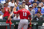 Cincinnati Reds' Joey Votto celebrates his two-run home run off Chicago Cubs starting pitcher Alec Mills outside the dugout during the first inning of a baseball game Thursday, July 29, 2021, in Chicago. Jesse Winker also scored on the play. (AP Photo/Charles Rex Arbogast)