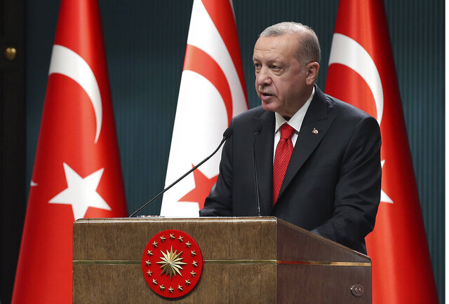 Turkey's President Recep Tayyip Erdogan speaks during a news conference, in Ankara, Turkey, Monday, Oct. 26, 2020. Erdogan, who has been railing against France for condoning caricatures of the prophet of Islam, called on Turkish citizens for the first time on Monday to boycott French products.(Turkish Presidency via AP, Pool)