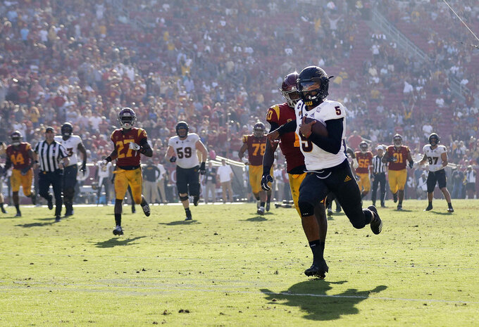 Arizona State quarterback Manny Wilkins (5) runs for a touchdown against Southern California during the second half of an NCAA college football game Saturday, Oct. 27, 2018, in Los Angeles. (AP Photo/Marcio Jose Sanchez)