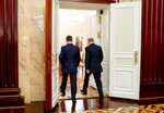 Russian President Vladimir Putin, right, and Russian Prime Minister Dmitry Medvedev leaves a cabinet meeting in Moscow, Russia, Wednesday, Jan. 15, 2020. The Tass news agency reports Wednesday that Russian Prime Minister Dmitry Medvedev submitted his resignation to President Vladimir Putin. Russian news agencies said Putin thanked Medvedev for his service but noted that the prime minister's Cabinet failed to fulfill all the objectives set for it. (Dmitry Astakhov, Sputnik, Government Pool Photo via AP)