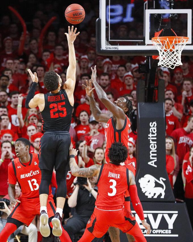 Houston's Galen Robinson Jr. (25) shoots against Cincinnati's Nysier Brooks, right, in the first half of an NCAA college basketball game, Sunday, March 10, 2019, in Cincinnati. (AP Photo/John Minchillo)