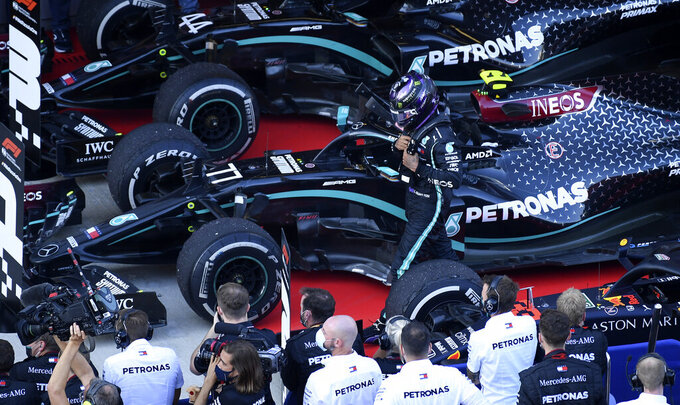 Mercedes driver Lewis Hamilton of Britain walks by his crew after placing third in the Russian Formula One Grand Prix, at the Sochi Autodrom circuit, in Sochi, Russia, Sunday, Sept. 27, 2020. (Kirill Kudryavtsev, Pool via AP)