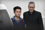 Chan Tong-kai, left, is accompanied by Rev. Peter Koon Ho-ming as he is released from prison in Hong Kong, Wednesday, Oct. 23, 2019. The release of Chan, a suspect in his girlfriend's murder in Taiwan, on Wednesday after serving a separate sentence and the legal tussle between Hong Kong and Taipei over his fate underscore deep political divisions between the Taiwan's freewheeling democracy and independent judiciary and China's tightly controlled, authoritarian one-party system. (AP Photo/Mark Schiefelbein)