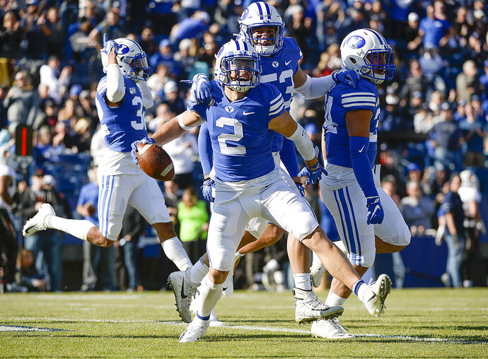 BYU defensive back Austin Lee (2) celebrates his 26-yard interception for a touchdown against Idaho State during an NCAA college football game, Saturday, Nov. 16, 2019, at LaVell Edwards Stadium, in Provo, Utah. (Leah Hogsten/The Salt Lake Tribune via AP)