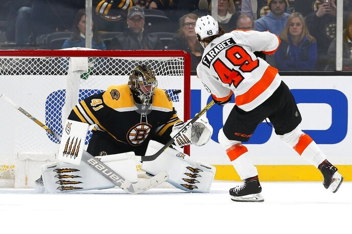 Philadelphia Flyers' Joel Farabee (49) scores on Boston Bruins' Jaroslav Halak (41) during the shootout in an NHL hockey game in Boston, Sunday, Nov. 10, 2019. (AP Photo/Michael Dwyer)