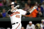 Baltimore Orioles' Mark Trumbo follows through on a swing at a pitch from Toronto Blue Jays starter Wilmer Font during the second inning of a baseball game Thursday, Sept. 19, 2019, in Baltimore. (AP Photo/Julio Cortez)