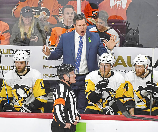 Pittsburgh Penguins coach Mike Sullivan makes his point with referee Kelly Sutherland during the second period in Game 6 of the first-round NHL hockey playoff series against the Philadelphia Flyers at the Wells Fargo Center, on April 22, 2018 photo, in Philadelphia. Where would the coach who turned around the Penguins' 2015-16 season spend his day with the Stanley Cup? In the heart of Bruins country, at his old high school, Boston College High School. (Peter Diana/Pittsburgh Post-Gazette via AP)